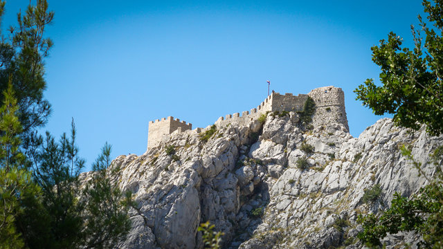 Bottom view of the ruins of the medieval pirate fortress Stari Grad in Omis, Croatia