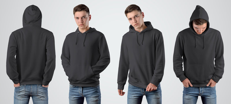 Mockup black blank hoodie on a young guy for design presentation.