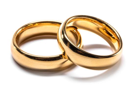 Gold wedding rings on white