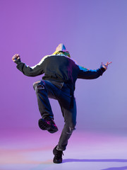 Breakdancing young man in hoodie and baseball cap. Dance school poster. Copy space. Battle competition announcement.