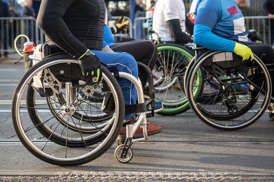 Disabled athlete on a wheelchair doing marathon.