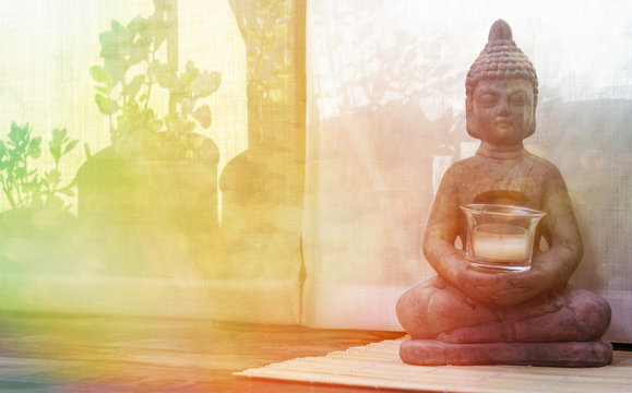 Buddha statue on the floor on a sunny morning.