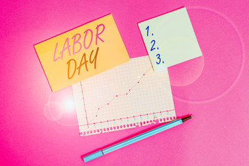 Writing note showing Labor Day. Business concept for an annual holiday to celebrate the achievements of workers Stationary and note paper math sheet with diagram picture on the table