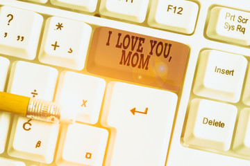 Word writing text I Love You Mom. Business photo showcasing Loving message emotional feelings affection warm declaration White pc keyboard with empty note paper above white background key copy space