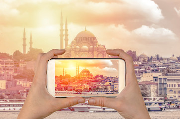 Tourist taking a picture in front of The Suleymaniye mosque at spring, Istanbul, Turkey. Travel concept