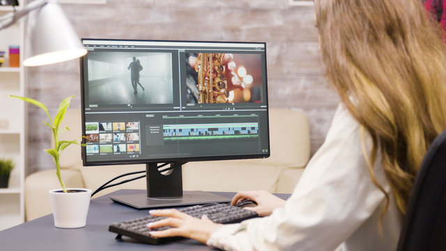 Creative female filmmaker working on post production of a movie