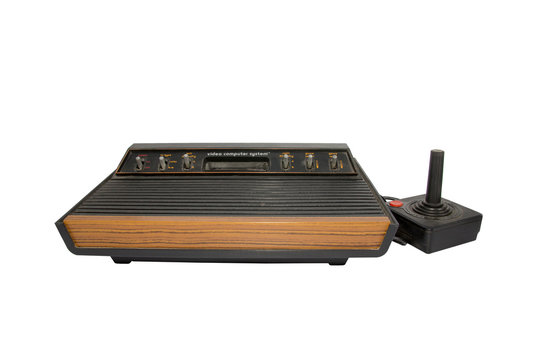 Old and vintage videogame Atari 2600 sixer wood edition in detail with white background