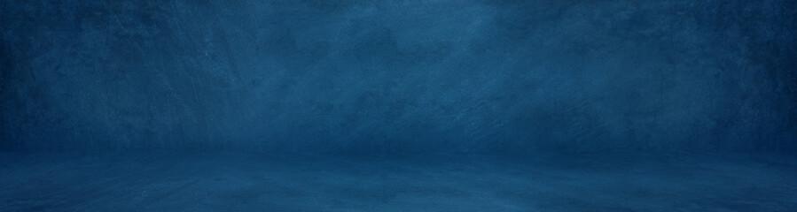 Fototapete - wide horizontal dark blue cement studio background to present product
