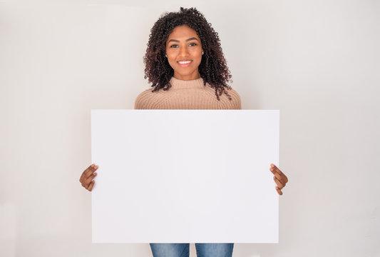 Black woman smile displaying white banner portrait