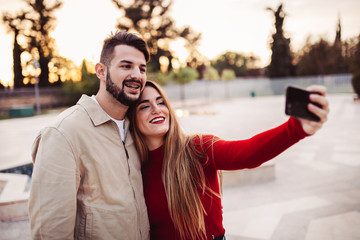 boy and girl making a selfie at sunset, lifestyle concept