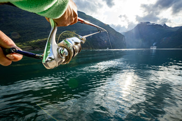 Poster Peche Woman fishing on Fishing rod spinning in Norway.