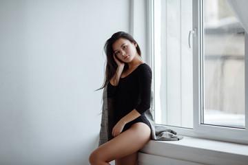 portrait of mixed race Asian Caucasian female in studio.