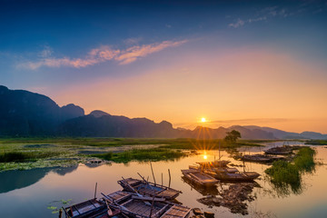 Foto op Canvas Nachtblauw Landscape with boat in Van Long natural reserve in Ninh Binh, Vietnam