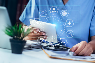 Doctor using digital laptop against dental equipment with medical network icon connection on modern virtual screen interface, medical technology networking concept.