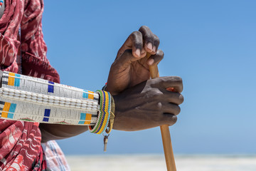 Tribal masai hand with a colorfull bracelet, closeup. Zanzibar, Tanzania, Africa