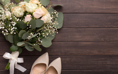 Beautiful luxury wedding bouquet and heels for bride