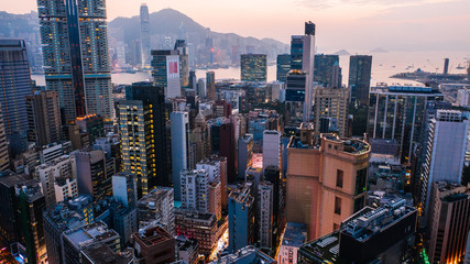Fotomurales - Aerial scenery panoramic view of Hong Kong modern skyscrapers district. Urban drone view with corporate business and financial enterprise buildings. Metropolitan city infrastructure in twilight time