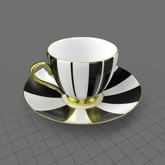 Striped coffee cup and saucer