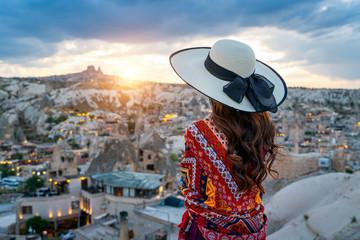 Wall Mural - Woman enjoying view of Goreme town, Cappadocia in Turkey.
