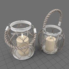 Lit candles with glass holders