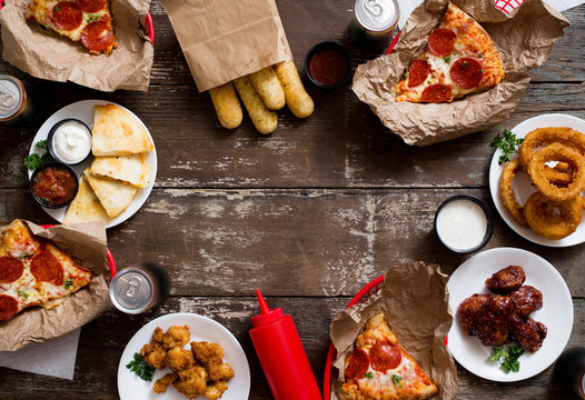 American Appetizer Party Spread with pizza, onion rings, wings, and quesadillas