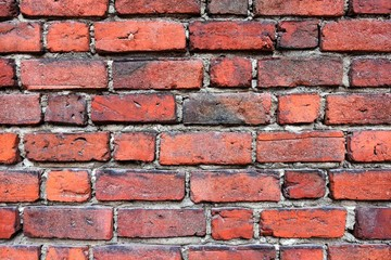 Grunge red brick wall with textured blocks, selective focus. Old stone wall. Red bricks background....