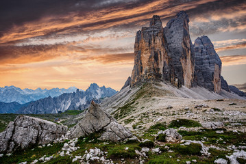 Fotomurales - Awesome alpine highlands during sunset. Amasing nature landscape. Tre Cime di Laveredo, three spectacular mountain peaks with colorful sky, Dolomites Alps, South Tyrol, Italy. Picture of wild area.
