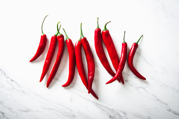 Canvas Prints Hot chili peppers Red hot chili peppers on white marble background. Healthy food, clean eating.