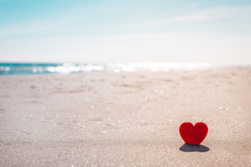Wall Murals Beach Romantic symbol of red heart on the sand beach