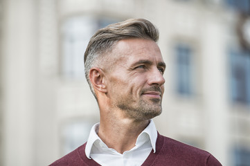 Facial care and ageing. Attractive mature man. Mature guy with grey hair and bristle outdoors. Men get more attractive with age. Hairdresser salon. Stylish hairstyle. Male face. Businessman concept Wall mural