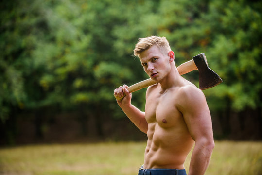 You can do it. Lumberjack woodman sexy naked athletic torso. Masculine concept. Illegal logging. woodsman with axe in hand. muscular man with axe. sexy macho bare belly ax. bodybuilding concept