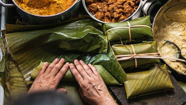 Overhead   shot of person preparing honduran tamales