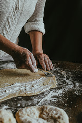 A Woman Prepares Homemade Braided Bread at Home