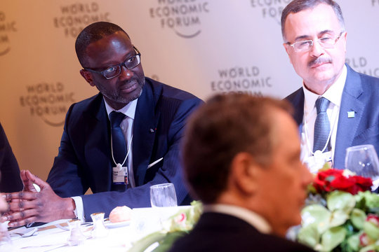 Credit Suisse CEO Thiam listens to other business leaders' remarks to U.S. President Donald Trump at a dinner for corporate chief executives alongside the World Economic Forum in Davos, Switzerland