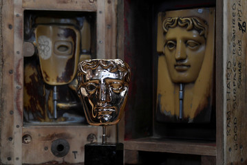 Foundry workers make the castings of the iconic British Academy of Film and Television Awards (BAFTA) masks, ahead of the annual awards ceremony, London