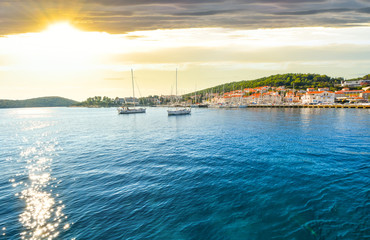 Sailboats in the Adriatic near Hvar Croatia as the sun sets