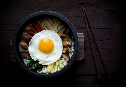 Dolsot Bibimbap topped with a sunny side egg.
