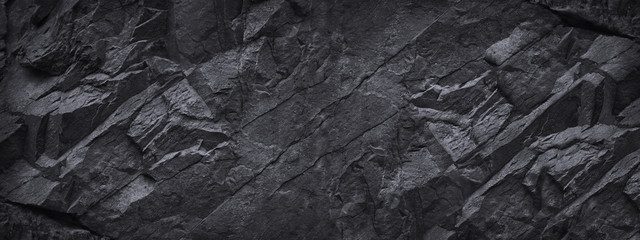 Poster Stenen Black stone background. Dark gray grunge banner. Black and white background. Mountain texture. Close-up. Volumetric. The rocky backdrop. Abstract black rock background. Detail.