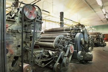 Self adhesive Wall Murals Old abandoned buildings An old machine at an abandoned textile factory in the morning sun