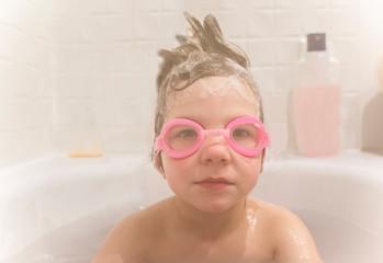 4 years boy wearing goggles.at bathtub