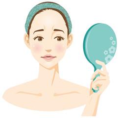 鏡を見て不満な顔をしている女性のイメージイラスト(美容)