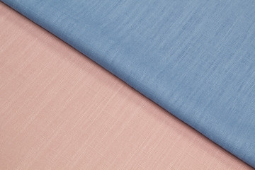 Fabric linen suit fold top view. Blue pink color textile