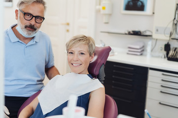 Smiling friendly woman in a dentists chair