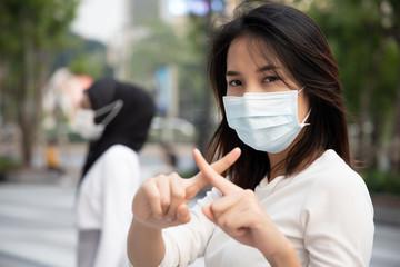 sick woman wearing mask, stopping virus outbreak; concept of biohazard, biological hazard,...