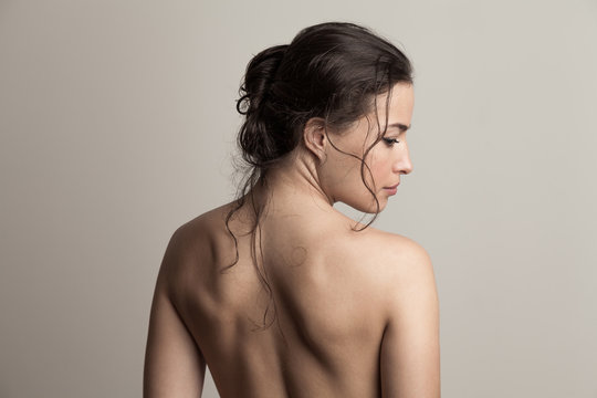 natural beauty concept young woman with wet hair in bun profile and back studio shot