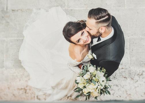 Beautiful wedding couple cuddling on their wedding day
