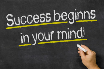 Success beginns in your mind written on a blackboard
