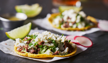 Wall Mural - carne asada mexican tacos with crumbled queso fresco cheese