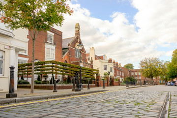 Street with cobblestones in historical old Portsmouth, Great Britain Fototapete