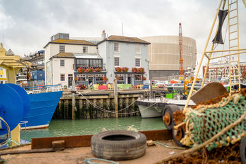 Canvas Prints Ship Old architecture and fisherman ships in historical dockyards of Portsmouth, Great Britain